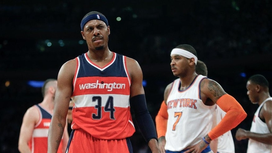 Washington Wizards' Paul Pierce (34) reacts to a call as New York Knicks' Carmelo Anthony (7) looks away during the first half of an NBA basketball game Tuesday, Nov. 4, 2014, in New York. (AP Photo/Frank Franklin II)