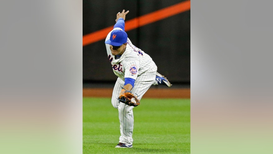 FILE - In this Sept. 9, 2014, file photo, New York Mets center fielder Juan Lagares catches a ball hit by Colorado Rockies' Vinny Castilla for an out during a baseball game in New York. Lagares was named a Gold Glove winner Tuesday, Nov. 4. (AP Photo/Frank Franklin II, File)