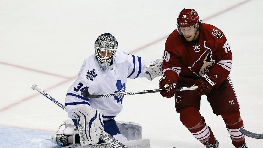 Toronto Maple Leafs goalie James Reimer (34) makes the save on Arizona Coyotes right wing Shane Doan (19) in the second period during an NHL hockey game, Tuesday, Nov. 4, 2014, in Glendale, Ariz. (AP Photo/Rick Scuteri)