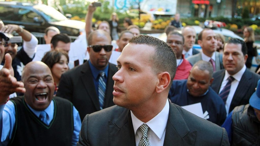 FILE - In this Oct. 1, 2013, file photo, New York Yankees' Alex Rodriguez arrives at the offices of Major League Baseball in New York. The U.S. government says New York Yankees star Alex Rodriguez paid his cousin almost $1 million to keep secret Rodriguez's use of performance enhancing drugs. In court documents filed last week in Miami, federal prosecutors say Rodriguez paid $900,000 last year to settle a threatened lawsuit by Yuri Sucart, who had worked as Rodriguez's personal assistant. Sucart, in a letter from his lawyer, threatened to expose Rodriquez's PED use if he wasn't paid $5 million. (AP Photo/David Karp, File)