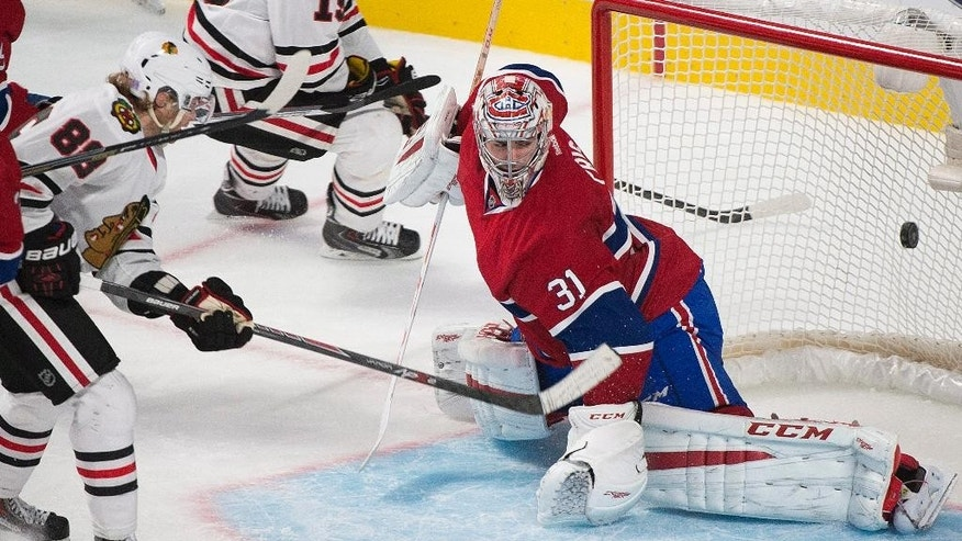 Chicago Blackhawks' Patrick Kane (88) scores on Montreal Canadiens goaltender Carey Price during the third period of an NHL hockey game, Tuesday, Nov. 4, 2014 in Montreal.  (AP Photo/The Canadian Press, Graham Hughes)