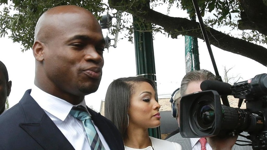 Minnesota Vikings running back Adrian Peterson arrives at the courthouse for an appearance Tuesday, Nov. 4, 2014, in Conroe, Texas. A judge presiding over Adrian Peterson's child abuse case may consider whether the Vikings star should be arrested for allegedly smoking marijuana while out on bond. (AP Photo/Pat Sullivan)
