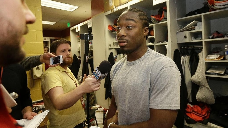 FILE - In this Jan. 20, 2014, file photo, San Francisco 49ers running back Marcus Lattimore speaks to reporters in the locker room at an NFL training facility in Santa Clara, Calif. Lattimore has informed the 49ers he plans to retire two years after a devastating knee injury. The team made the announcement Wednesday, Nov. 5, 2014, two days after coach Jim Harbaugh said Lattimore was weighing his football future. (AP Photo/Jeff Chiu, File)