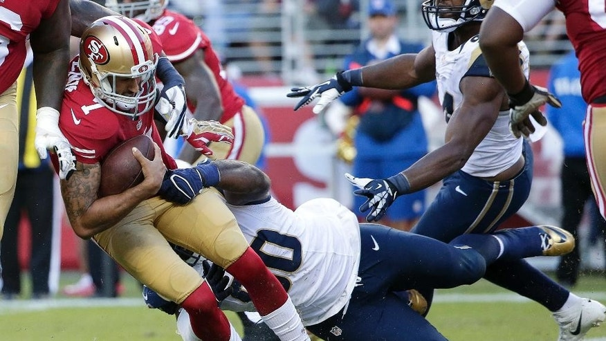 San Francisco 49ers quarterback Colin Kaepernick (7) is sacked by St. Louis Rams defensive tackle Michael Brockers during the fourth quarter of an NFL football game in Santa Clara, Calif., Sunday, Nov. 2, 2014. (AP Photo/Marcio Jose Sanchez)