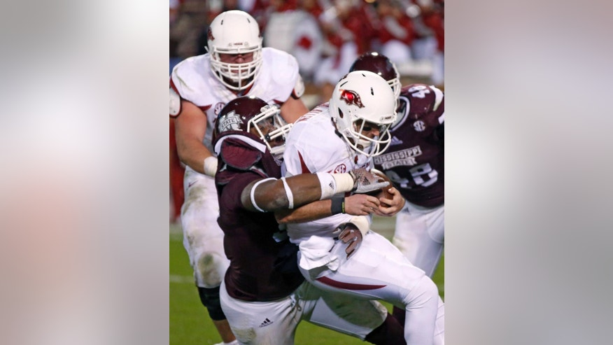 Arkansas quarterback Brandon Allen (10) is sacked by Mississippi State defensive lineman Chris Jones, left, in the second half of an NCAA college football game in Starkville, Miss., Saturday, Nov. 1, 2014. No. 1 Mississippi State won 17-10. (AP Photo/Rogelio V. Solis)