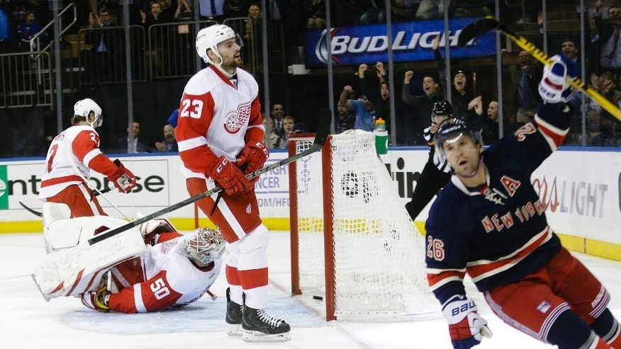 New York Rangers' Martin St. Louis (26) reacts after shooting the puck past Detroit Red Wings goalie Jonas Gustavsson (50), of Sweden, for a goal during the second period of an NHL hockey game Wednesday, Nov. 5, 2014, in New York.  (AP Photo/Frank Franklin II)