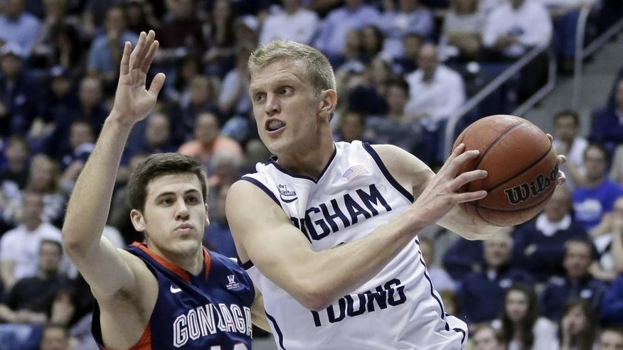 FILE - In this Feb. 20, 2014, file photo, Brigham Young's Tyler Haws (3) pulls down a rebound as Gonzaga's Drew Barham (43) defends in the second half of an NCAA college basketball game in Provo, Utah. By the time this season is over, Haws' name could be the one at the top of the BYU record books. (AP Photo/Rick Bowmer, File)
