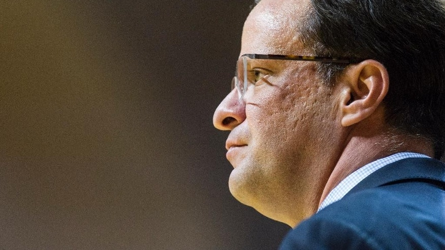 FILE - In this March 5, 2014, file photo, Indiana head coach Tom Crean watches the action on the court during the second half of an NCAA college basketball game against Nebraska in Bloomington, Ind. Three players have been suspended. A fourth is injured. The coach is under fire. And Indiana's first exhibition game, Thursday night, Nov. 6, 2014,  against Northwood, can't get here fast enough.(AP Photo/Doug McSchooler, File)