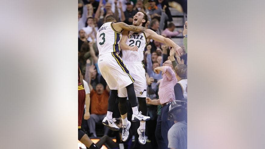 Utah Jazz's Gordon Hayward (20) celebrates with guard Trey Burke (3) after scoring against the Cleveland Cavaliers at the end of an NBA basketball game Wednesday, Nov. 5, 2014, in Salt Lake City. Utah won 102-100. (AP Photo/Rick Bowmer)