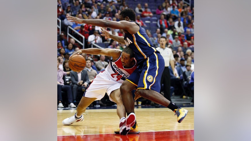 Washington Wizards guard Andre Miller (24) can't get past Indiana Pacers forward Solomon Hill during the first half of an NBA basketball game, Wednesday, Nov. 5, 2014, in Washington. (AP Photo/Alex Brandon)