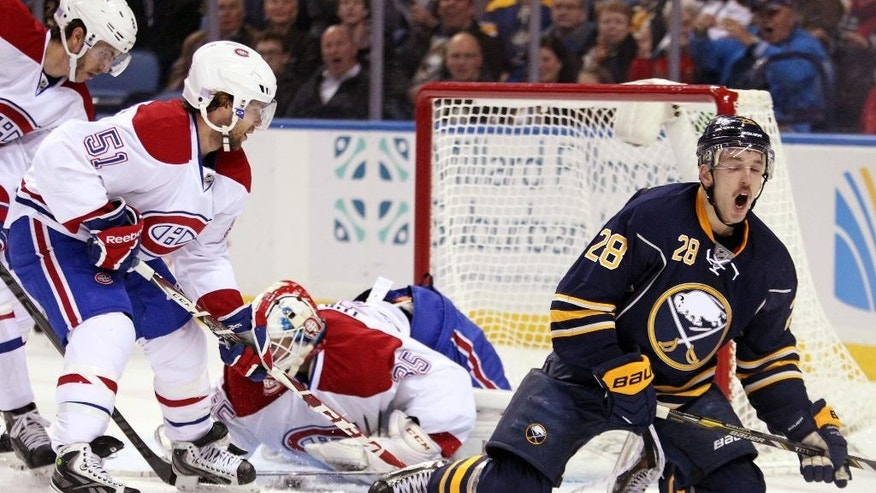 Buffalo Sabres' Zemgus Girgensons (28), of Latvia, reacts after his shot was blocked by Montreal Canadiens' Dustin Tokarski (35) and David Desharnais (51) during the first period of an NHL hockey game Wednesday, Nov. 5, 2014, in Buffalo, N.Y. (AP Photo/Jen Fuller)