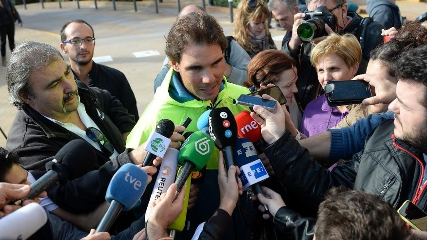 Spanish tennis player Rafael Nadal talks with the media in front of  the hospital after successfully undergoing an operation to remove his appendix in Barcelona, Spain, Wednesday, Nov. 5, 2014. A month ago, the tennis star tried to play through suspected appendicitis at the Shanghai Masters but acknowledged experiencing discomfort and was ousted in the second round by fellow Spaniard Feliciano Lopez. Nadal tried to treat his appendix with antibiotics before opting for an appendectomy. Nadal's appendix was removed on Monday using laparoscopy or key-hole surgery, a statement said. (AP Photo/Manu Fernandez)