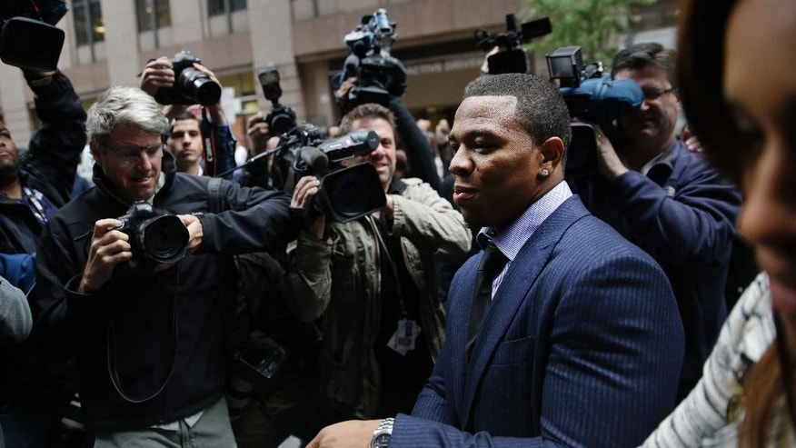 Ray Rice arrives with his wife Janay Palmer for an appeal hearing of his indefinite suspension from the NFL, Wednesday, Nov. 5, 2014, in New York. (AP Photo/Seth Wenig)