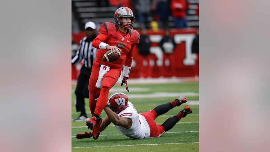 Rutgers quarterback Chris Laviano looks to pass the ball as he scrambles away from Wisconsin defensive end Alec James during the second half of an NCAA college football game, Saturday, Nov. 1, 2014, in Piscataway, N.J. Wisconsin won 37-0. (AP Photo/Mel Evans)