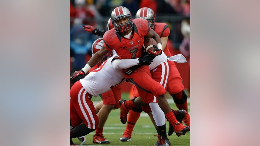 Rutgers running back Robert Martin (7) runs for yardage against the Wisconsin defense during the second half of an NCAA college football game against Rutgers, Saturday, Nov. 1, 2014, in Piscataway, N.J. Wisconsin won 37-0. (AP Photo/Mel Evans)