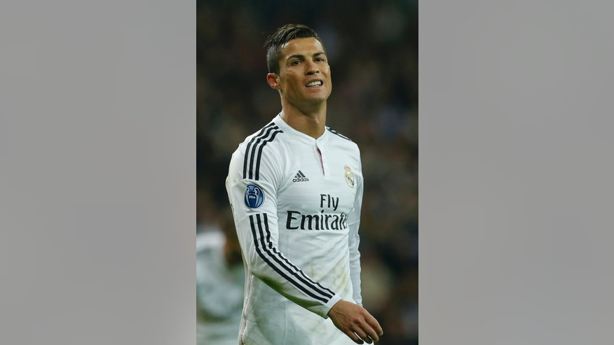 Real Madrid's Cristiano Ronaldo gestures during a Group B Champions League soccer match between Real Madrid and Liverpool at the Santiago Bernabeu stadium in Madrid, Spain, Tuesday Nov. 4, 2014. (AP Photo/Paul White)