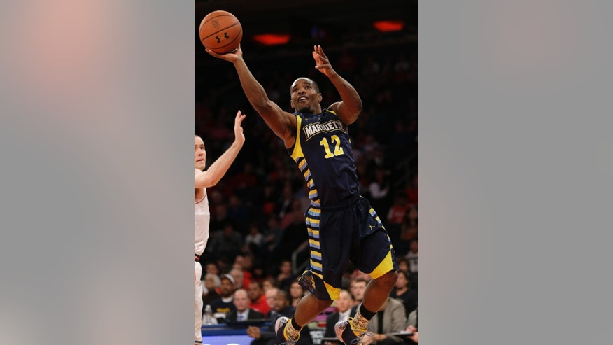 FILE - In this Feb. 1, 2014, file photo, Marquette's Derrick Wilson drives to the basket during the second half of an NCAA basketball game against St. John's at Madison Square Garden in New York. (AP Photo/Seth Wenig, File)