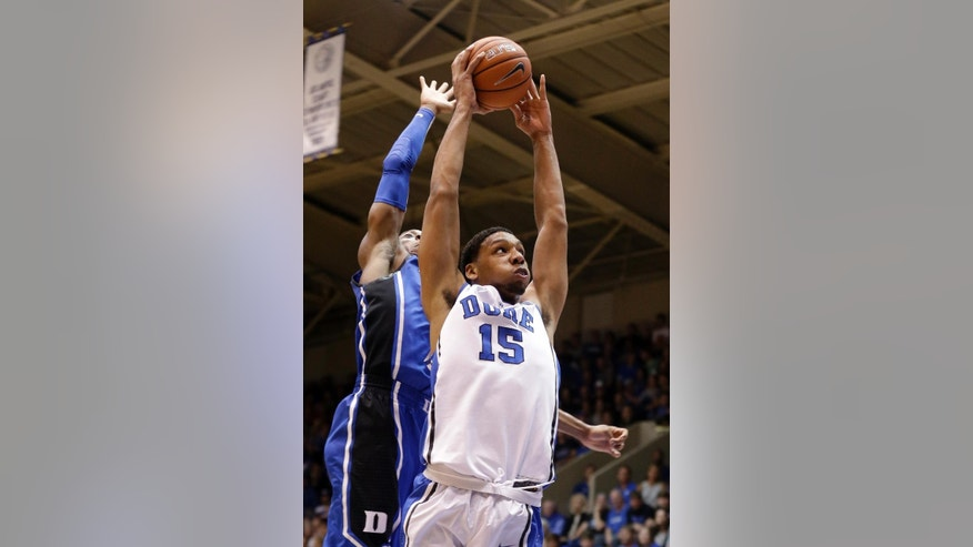 FILE - In this Oct. 25, 2014, file photo, Duke's Jahlil Okafor drives to the basket in front of Rasheed Sulaimon as the team kicks off its NCAA college basketball season in a scrimmage during Countdown to Craziness at Cameron Indoor Stadium in Durham, N.C. The 6-foot-11, 270-pound forward from Chicago has already made a big impression, getting selected as a preseason AP All-American before his first game for the Blue Devils. (AP Photo/Gerry Broome, File)