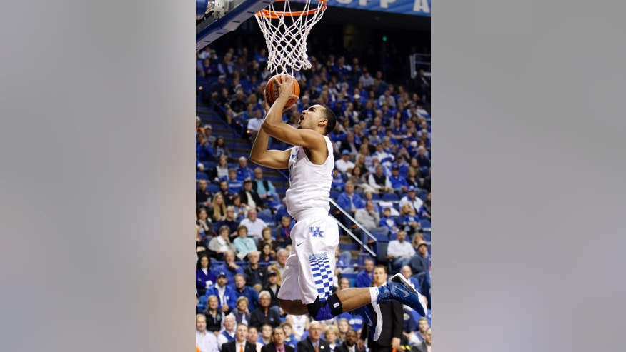 FILE - In this Nov. 2, 2014, file photo, Kentucky's Trey Lyles shoots during an NCAA college basketball exhibition game against Pikeville in Lexington, Ky. The 6-11 Karl-Anthony Towns, a three-time All-State player in New Jersey, and 6-10 Lyles, whose made the game-winning free throw in his final prep game to clinch an Indiana state title, both averaged more than 20 points and about 13 rebounds a game as high school seniors. (AP Photo/James Crisp, File)