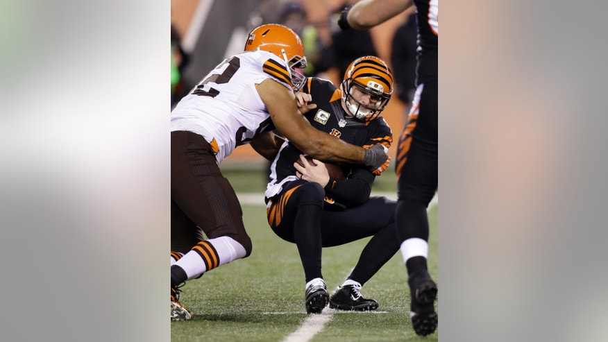 Cincinnati Bengals quarterback Andy Dalton is sacked by Cleveland Browns defensive end Desmond Bryant during the second half of an NFL football game Thursday, Nov. 6, 2014, in Cincinnati. (AP Photo/AJ Mast)