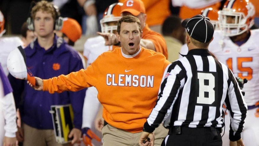 Clemson head coach Dabo Swinney, front left, argues a call during the second half of an NCAA college football game against Wake Forest in Winston-Salem, N.C., Thursday, Nov. 6, 2014. (AP Photo/Chuck Burton)