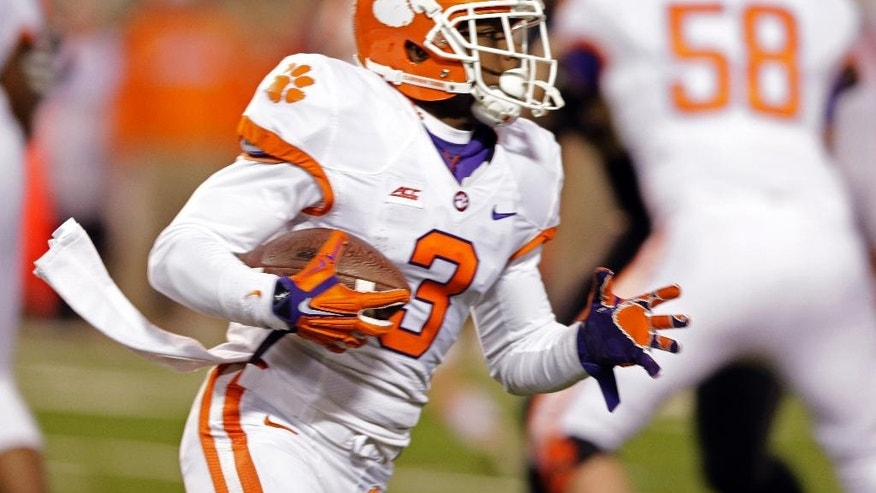 Clemson's Artavis Scott (3) turns the corner on a long touchdown run against Wake Forest during the second half of an NCAA college football game in Winston-Salem, N.C., Thursday, Nov. 6, 2014. (AP Photo/Chuck Burton)