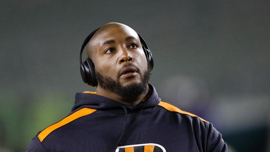 Cincinnati Bengals defensive tackle Devon Still prepares for an NFL football game between the Bengals and the Cleveland Browns on Thursday, Nov. 6, 2014, in Cincinnati. Still's 4-year-old daughter, Leah, who is battling cancer, was expected be in attendance to watch him play for the first time. (AP Photo/Michael Conroy)