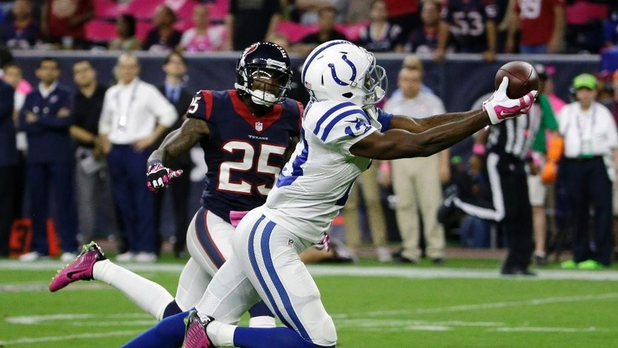 FILE - In this Oct. 9, 2014, file photo, Indianapolis Colts' T.Y. Hilton (13) catches a pass in front of Houston Texans' Kareem Jackson (25) during the first quarter of an NFL football game in Houston. Hilton broke out last year with 82 receptions for 1,083 yards, taking over as Andrew Luck's favorite target after Reggie Wayne went down with an injury. Still, he wasn't generally mentioned before this season as being in the upper echelon of the league's wide receivers with guys such as Calvin Johnson, Julio Jones and Dez Bryant.(AP Photo/David J. Phillip, File)