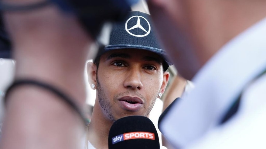 Mercedes driver Lewis Hamilton of Britain talks with the media at the Interlagos circuit in Sao Paulo, Brazil, Thursday, Nov. 6, 2014.  The duel for the Formula One title arrived in Brazil with Mercedes teammates Hamilton and Nico Rosberg fighting to get into good position ahead of the season-ending race in Abu Dhabi later this month. (AP Photo/Andre Penner)