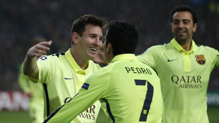 Barcelona's Lionel Messi celebrates with team mates scoring his side's 2nd goal during the Group F Champions League match between AFC Ajax and FC Barcelona at ArenA stadium in Amsterdam, Netherlands, Wednesday, Nov. 5, 2014. (AP Photo/Peter Dejong)