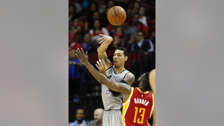 San Antonio Spurs guard Danny Green, left, passes the ball away from Houston Rockets guard James Harden (13) during the second quarter of an NBA basketball game, Thursday, Nov. 6, 2014, in Houston. (AP Photo/Patric Schneider)