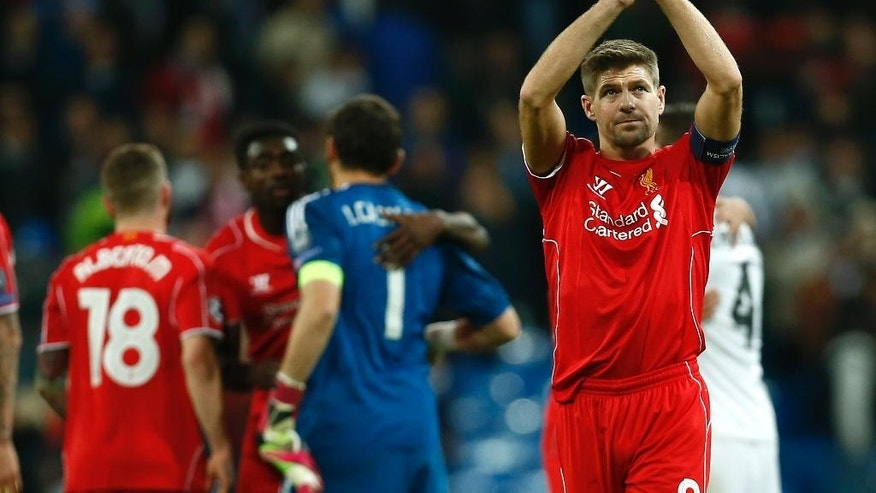 Liverpool's Steven Gerrard applauds the crowd after a Group B Champions League soccer match between Real Madrid and Liverpool at the Santiago Bernabeu stadium in Madrid, Spain, Tuesday Nov. 4, 2014. Liverpool lost the match 1-0. (AP Photo/Andres Kudacki)