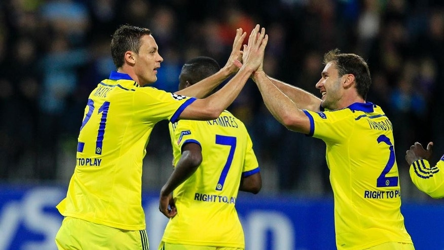 Chelsea's Nemanja Matic, left, celebrates his goal with teammates during the Champions League group G soccer match between Chelsea FC and Maribor, in Maribor, Slovenia, Wednesday, Nov. 5, 2014.(AP Photo/Nikola Solic)
