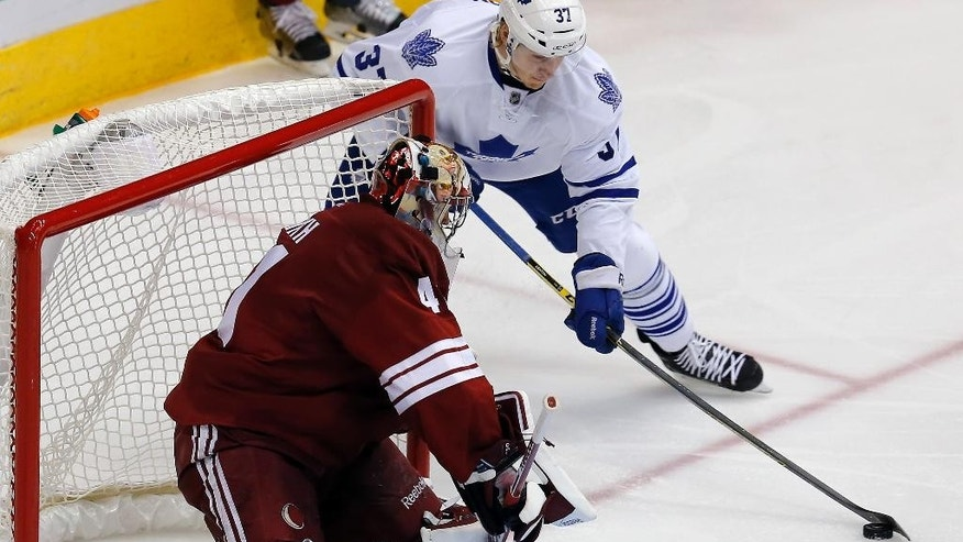 Toronto Maple Leafs right wing Carter Ashton (37) tries to score on Arizona Coyotes goalie Mike Smith during the third period during an NHL hockey game, Tuesday, Nov. 4, 2014, in Glendale, Ariz. Phoenix won 3-2. (AP Photo/Rick Scuteri)