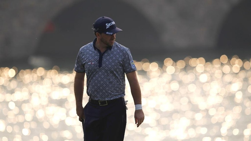 Graeme Mcdowell of Northern Ireland walks on the 9th hole during the first round of the HSBC Champions golf tournament at the Sheshan International Golf Club in Shanghai, China, Thursday, Nov. 6, 2014. (AP Photo)