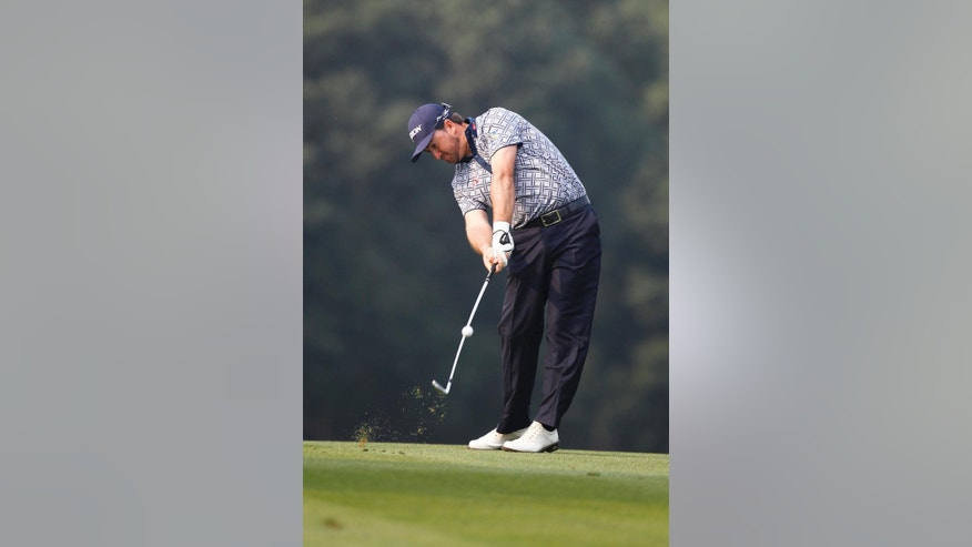 Graeme Mcdowell of Northern Ireland hits a shot on the 9th hole during the first round of the HSBC Champions golf tournament at the Sheshan International Golf Club in Shanghai, China, Thursday, Nov. 6, 2014. (AP Photo)