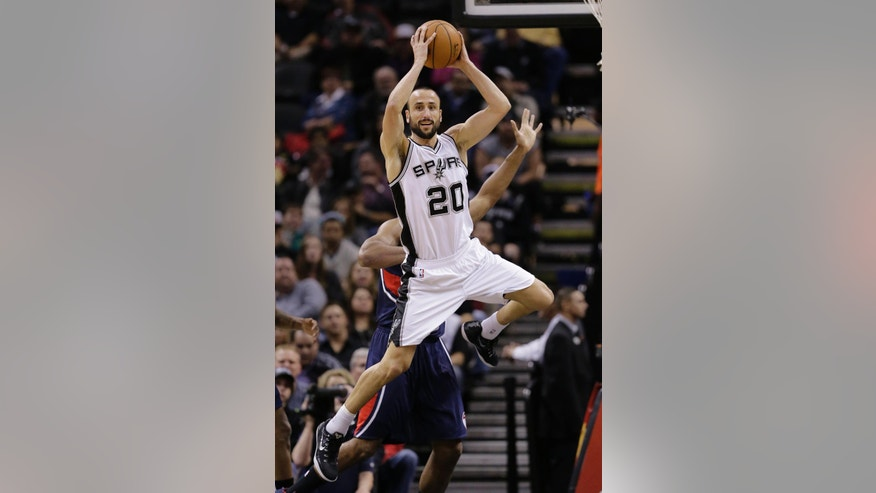 San Antonio Spurs' Manu Ginobili (20) looks to pass against the Atlanta Hawks during the first half of an NBA basketball game, Wednesday, Nov. 5, 2014, in San Antonio. (AP Photo/Eric Gay)