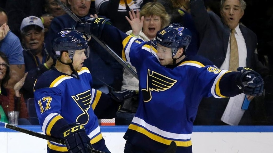 St. Louis Blues' Jaden Schwartz, left, is congratulated by teammate Vladimir Tarasenko, of Russia, after scoring during the second period of an NHL hockey game against the New Jersey Devils, Thursday, Nov. 6, 2014, in St. Louis. (AP Photo/Jeff Roberson)