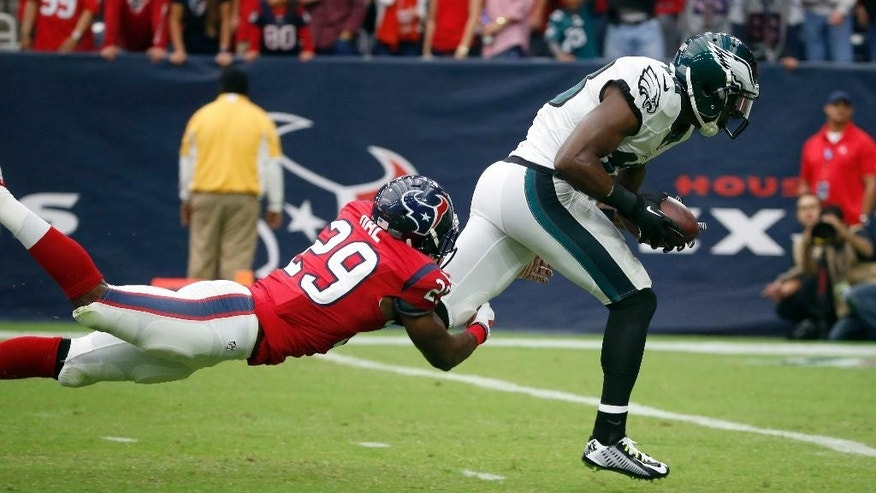 Philadelphia Eagles wide receiver Jeremy Maclin, right, heads to the end zone as Houston Texans defensive back Andre Hal defends after catching a 59-yard pass for a touchdown during the first quarter of an NFL football game, Sunday, Nov. 2, 2014, in Houston. (AP Photo/Tony Gutierrez)