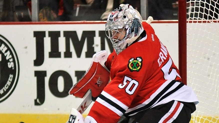 Chicago Blackhawks goalie Corey Crawford makes a save during the first period of an NHL hockey game against the Washington Capitals in Chicago, Friday, Nov. 7, 2014. (AP Photo/Paul Beaty)