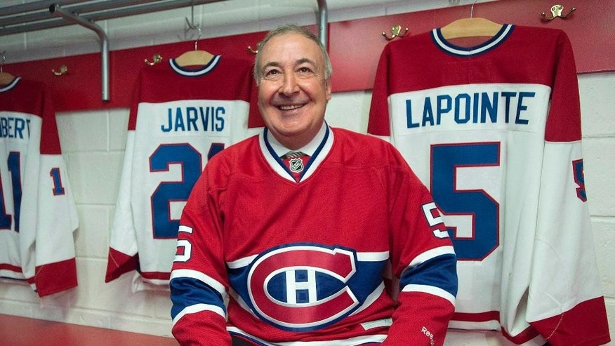 FILE - In this June 19, 2014, file photo, Montreal Canadiens great Guy Lapointe smiles at the Canadiens Hall of Fame in Montreal. Lapointe's jersey retirement ceremony will take place Saturday, Nov. 8, 2014, before a hockey game against the Minnesota Wild, for which Lapointe serves as coordinator of amateur ccouting. (AP Photo/The Canadian Press, Graham Hughes, File)