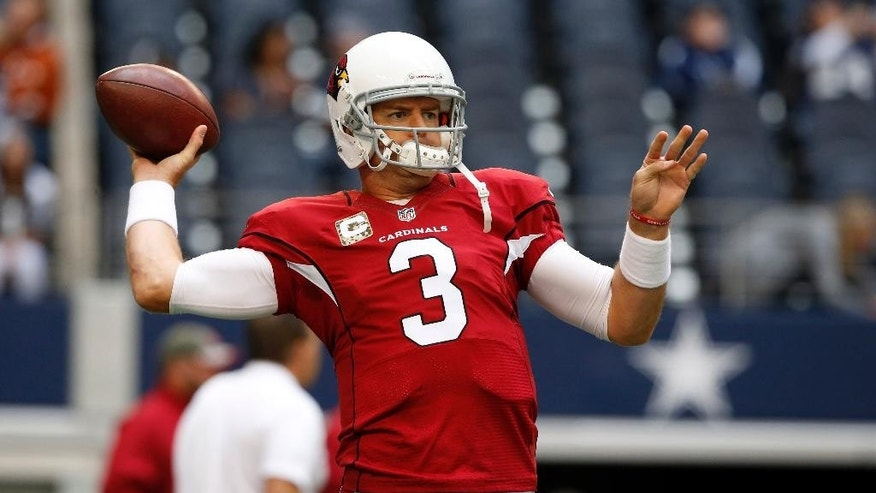 Arizona Cardinals quarterback Carson Palmer (3) warms up before an NFL football game against the Dallas Cowboys Sunday, Nov. 2, 2014, in Arlington, Texas. (AP Photo/Sue Ogrocki)