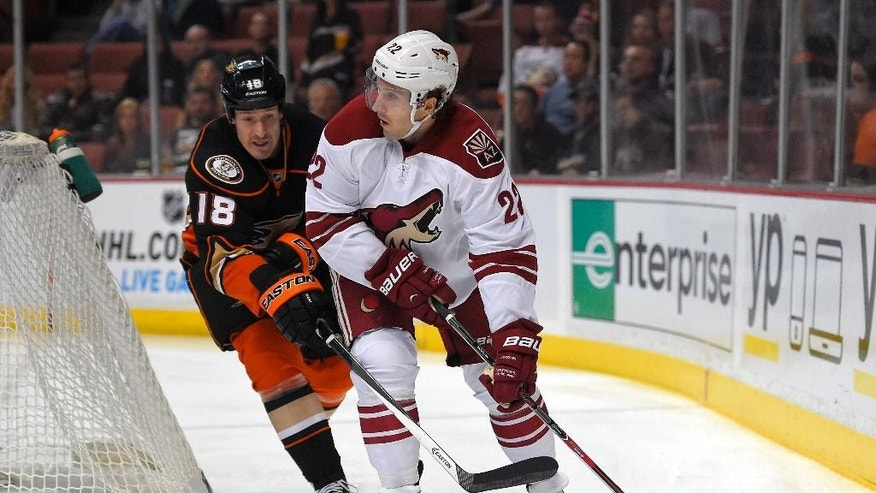 Anaheim Ducks right wing Tim Jackman, left, and Arizona Coyotes left wing Brandon McMillan battle for the puck during the first period of an NHL hockey game, Friday, Nov. 7, 2014, in Anaheim, Calif. (AP Photo/Mark J. Terrill)