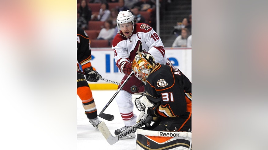Arizona Coyotes right wing Shane Doan, left, tries to get a shot in against Anaheim Ducks goalie Frederik Andersen, of Denmark, during the first period of an NHL hockey game, Friday, Nov. 7, 2014, in Anaheim, Calif. (AP Photo/Mark J. Terrill)