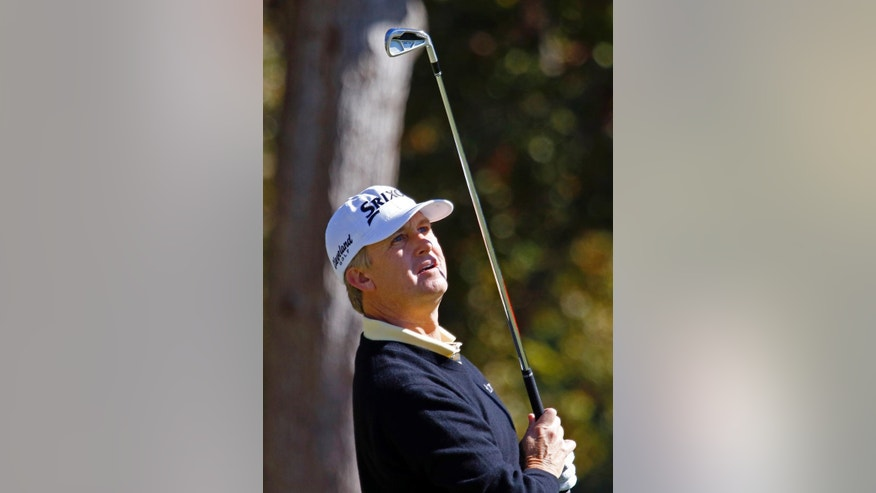 David Toms watches his shot from the eighth fairway during the second round of the Sanderson Farms golf tournament on Friday, Nov. 7, 2014, in Jackson, Miss. Toms finished the day with a 10-under 66. (AP Photo/Rogelio V. Solis)
