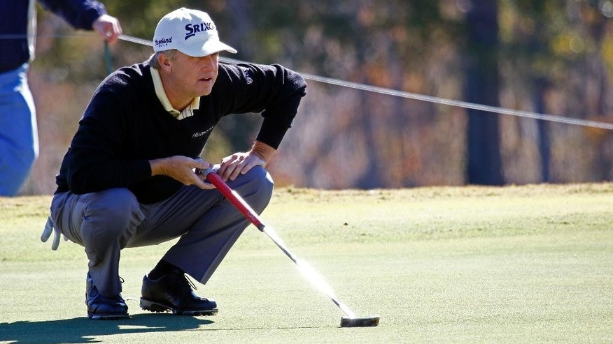 David Toms studies his lay before putting on the seventh hole during the second round of the Sanderson Farms golf tournament on Friday, Nov. 7, 2014, in Jackson, Miss. Toms finished the day with a 10-under 66. (AP Photo/Rogelio V. Solis)