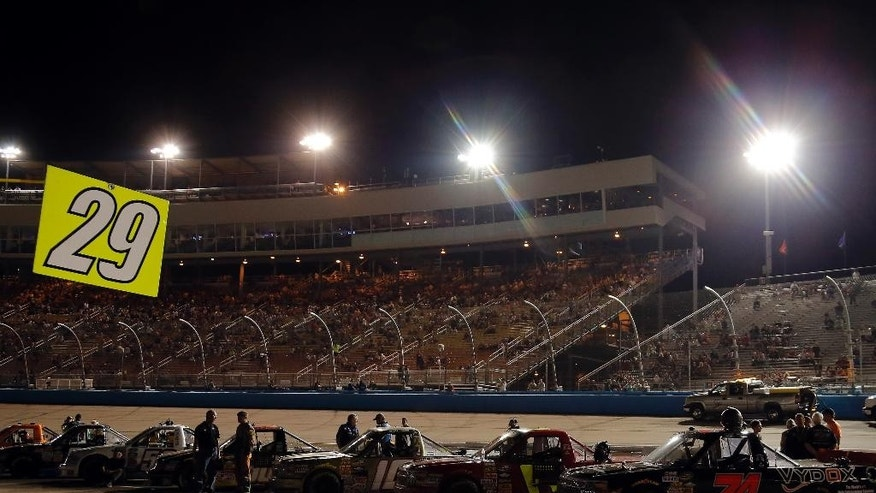 A power outage delays a NASCAR Camping World Truck Series auto race at Phoenix International Raceway in Avondale, Ariz., Friday, Nov. 7, 2014. (AP Photo/Rick Scuteri)