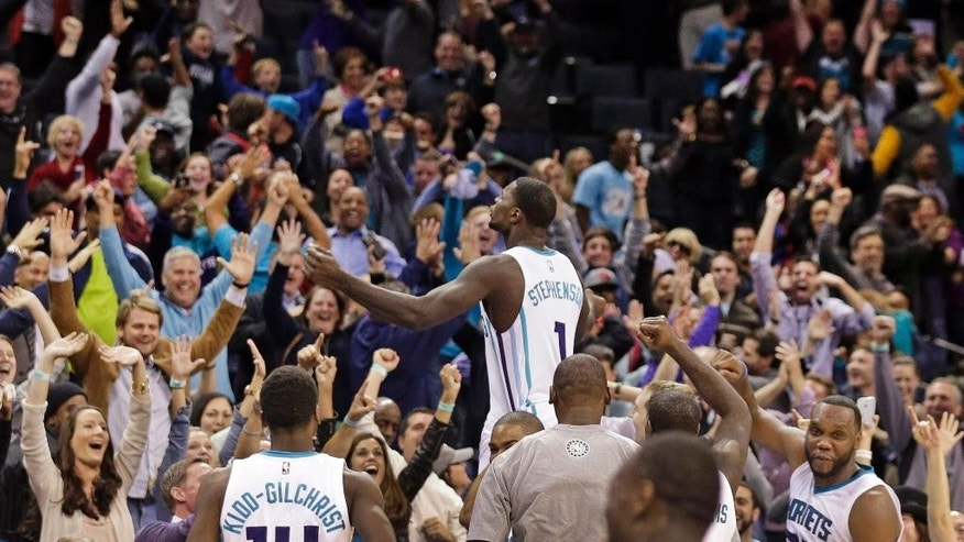 Charlotte Hornets' Lance Stephenson (1) celebrates his game-winning basket with the crowd after an NBA basketball game against the Atlanta Hawks in Charlotte, N.C., Friday, Nov. 7, 2014. The Hornets won 122-119 in double overtime. (AP Photo/Chuck Burton)