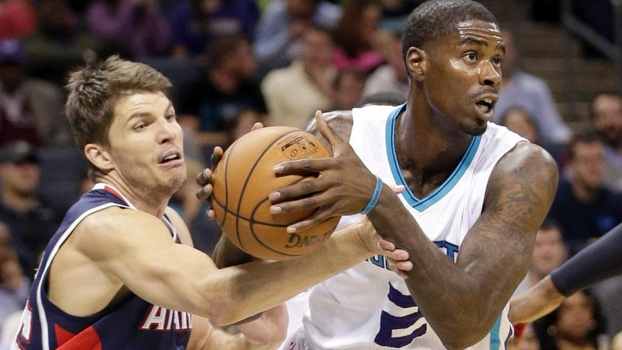 Charlotte Hornets' Marvin Williams (2) steals the ball from Atlanta Hawks' Kyle Korver (26) during the first half of an NBA basketball game in Charlotte, N.C., Friday, Nov. 7, 2014. (AP Photo/Chuck Burton)