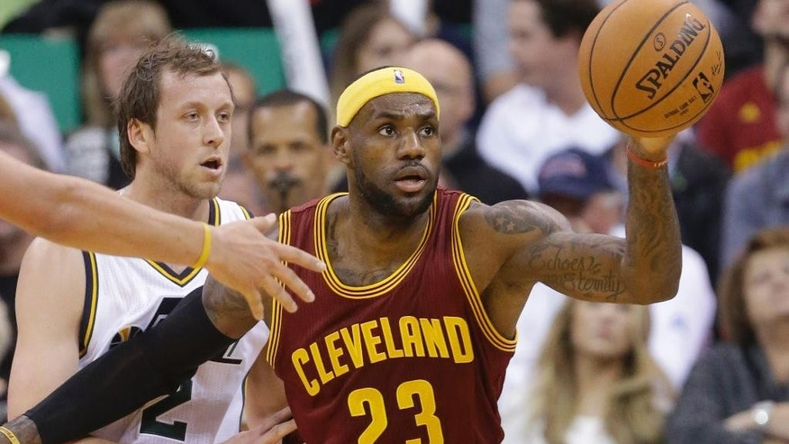 Cleveland Cavaliers' LeBron James (23) catches a pass as Utah Jazz's  Joe Ingles (2) defends in the second quarter during an NBA basketball game, Wednesday, Nov. 5, 2014, in Salt Lake City. (AP Photo/Rick Bowmer)